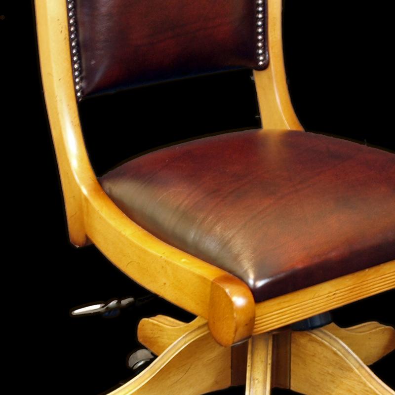 Upholstered swivel desk